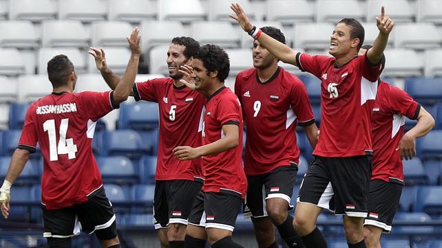 Egypt celebrate their third goal against Belarus