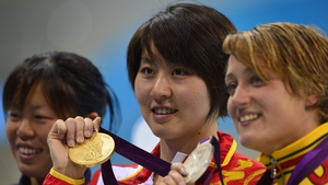 Jiao Liuyang with gold, Spain's Mireia Belmonte with silver (R) and Natsumi Hoshi of Japan with their 200 metres butterfly medals