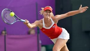 Maria Sharapova grimaces as she returns a Sabine Lisicki serve