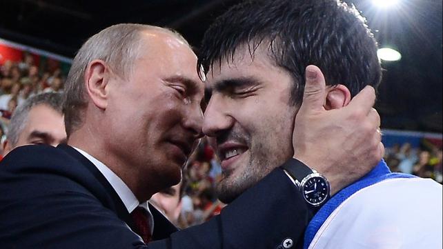 Vladimir Putin enthusiastically congratulates Tagir Khaybulaev