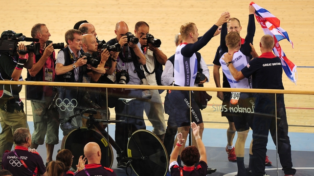 Chris Hoy and Philip Hindes are mobbed after winning gold in world record time