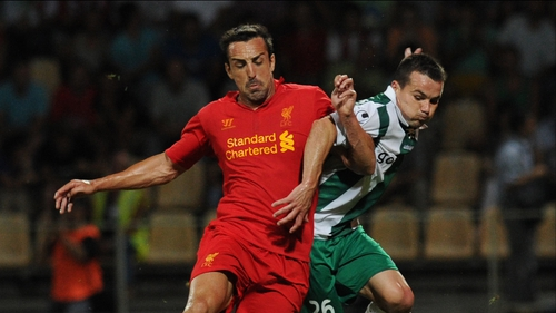 Jose Enrique (L) of Liverpool vies with Gomel's Tomasz Novak for posession