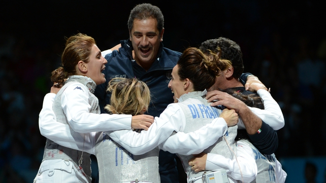 The Italian team celebrates winning gold during the women's foil final