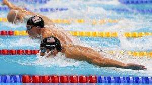 Michael Phelps took 200m IM gold in the Duel in the Pool with compatriot Ryan Lochte securing silver