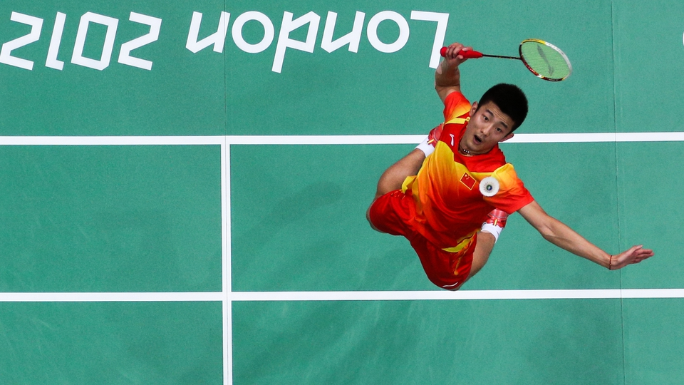 Chen Long of China returns a shot against Denmark's Peter Gade in the Men's Singles Badminton quarter final
