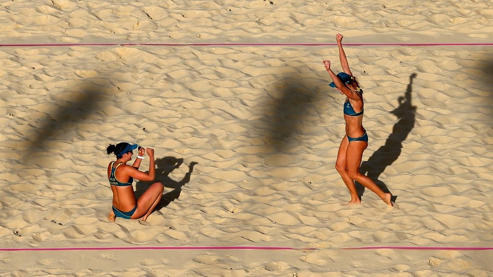 Louise Bawden and Becchara Palmer of Australia celebrate victory during the Women's Beach Volleyball this afternoon