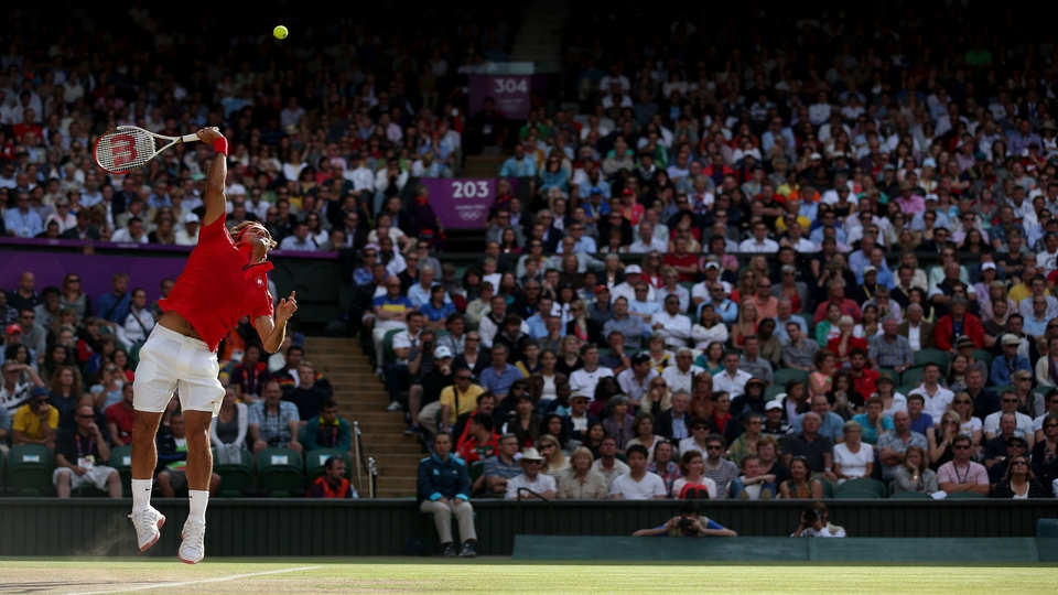 Roger Federer serving at Wimbledon this afternoon