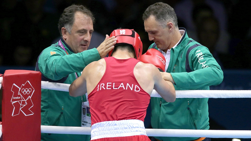 Ireland's Darren O'Neill is consoled after defeat in his round of 16 bout