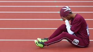 Qatari sprinter Noor Al-Malki is disraught after having to drop out of the Women's