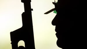 Leuris Pupo of Cuba prepares for a practice session with his pistol ahead of the Beijing 2008 Olympics
