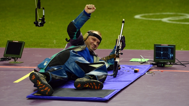 Sergei Martynov cracks a smile after winning gold