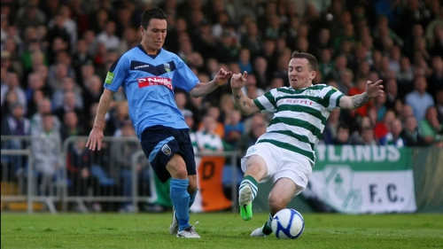 UCD's Tyrone McNeils is challenged by Gary McCabe of Shamrock Rovers