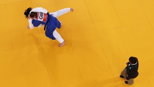 Iryna Kindzerska of Ukraine gets tackled by GB's Karina Bryant in the 78kg judo