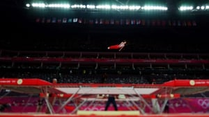 A tilt-shift view of Yasuhiro Ueyama in the men's trampoline