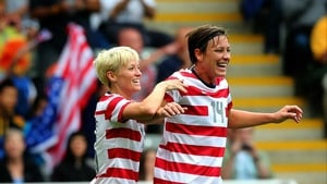 Abby Wambach (r) celebrates with US team-mate Megan Rapinoe after scoring against New Zealand