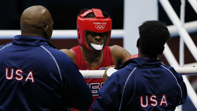 Rau'shee Warren of the USA is greeted by his corner after facing Nordine Oubaali of France