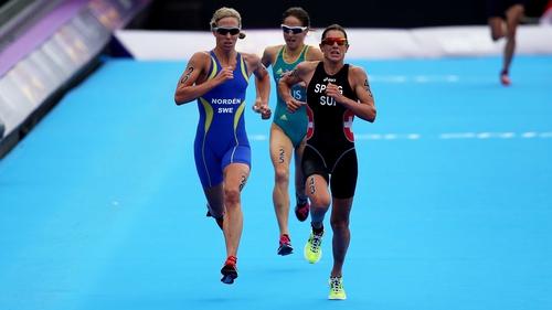 Nicola Spirig (r) of Switzerland just held the run of Sweden's Lisa Norden, to win gold in the women's triathlon