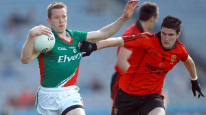 Down's Niall McParland tests the quality of Donal Vaughan's jersey