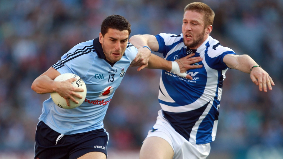 Cahir Healy of Laois (r) kept a close eye on Dublin dangerman Bernard Brogan
