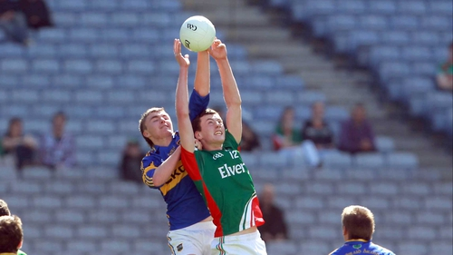 Diarmuid O'Connor of Mayo and Colman Kennedy of Tipperary compete for a high ball in the MFC quarter-final at Croke Park