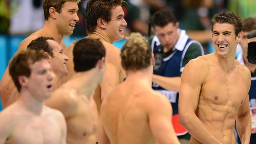 Phelps (r) and the rest of the relay squad celebrate their victory