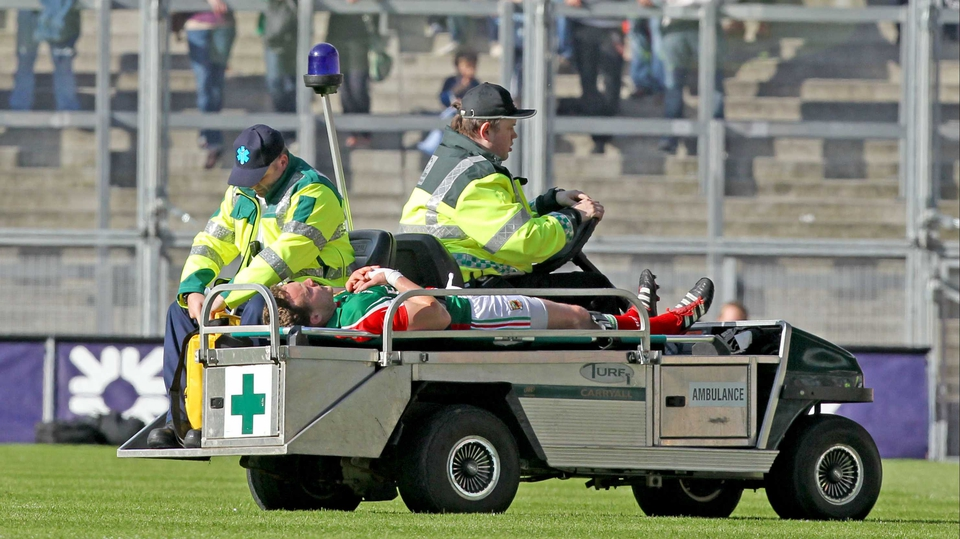Mayo captain Andy Moran leaves the field injured