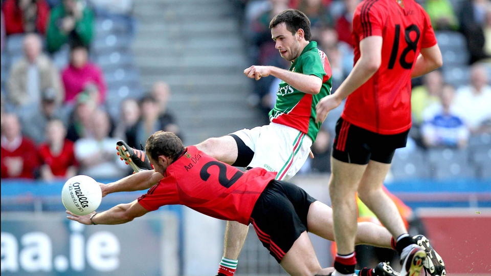 Darren O'Hagan attempts to block down Mayo's Kevin McLoughlin