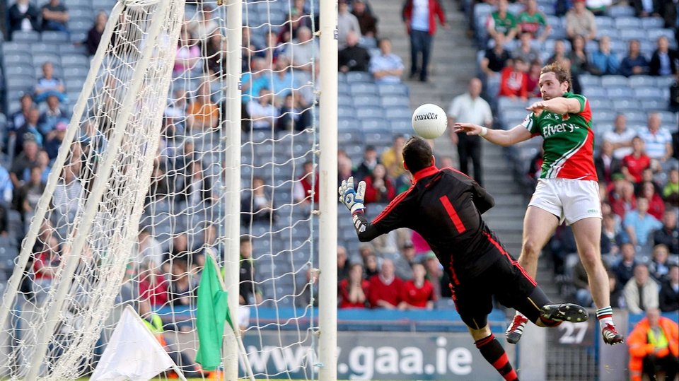 Mayo's Michael Conroy finishes his side's third goal to the net