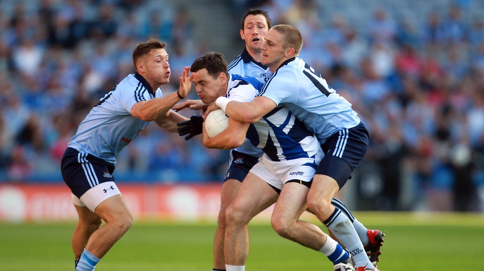 John O'Loughlin of Laois is surrounded by Dublin trio Paul Flynn (l), Denis Bastick and Eoghan O'Gara (r)