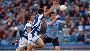 Michael Darragh Macauley's fisted effort is deflected to the Laois net by John O'Loughlin