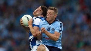 Dublin's Paul Flynn barges into the back of Colm Begley of Laois