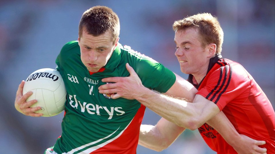 Down were the opponents in the All-Ireland quarter-final, where Mayo centre-forward Cillian O'Connor (l) found himself pursued by Brendan McArdle