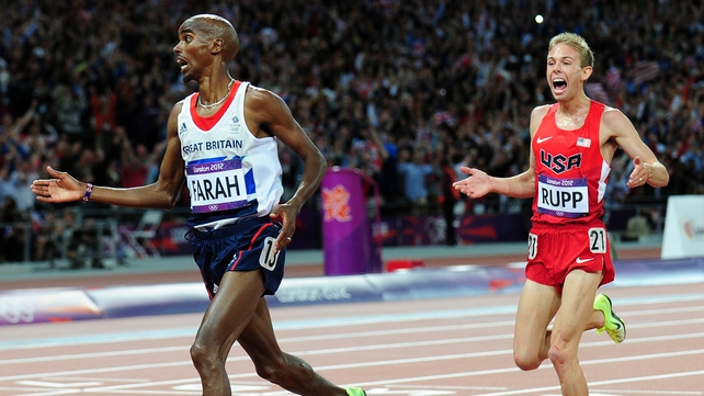Mo Farah crosses the line to take 10,000m gold followed by training partner Galen Rupp from the USA