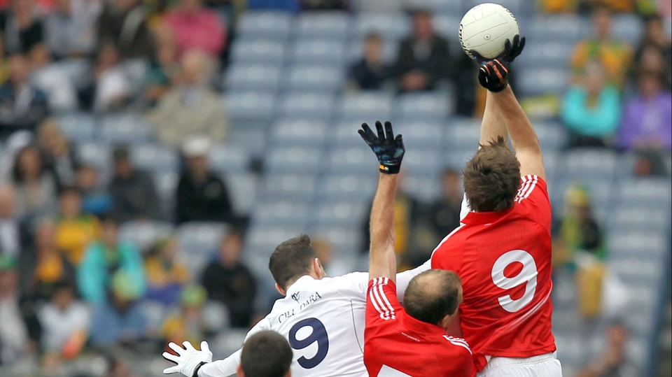 Kildare's Robert Kelly competes with Paudie Kissane and Aidan Walsh of Cork for a high ball