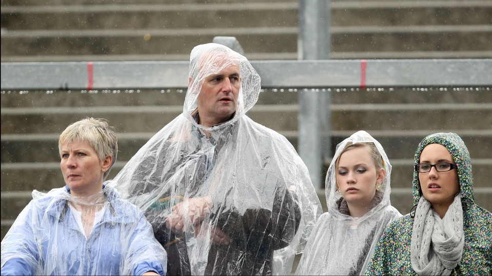Fans watch the Roscommon v Kerry game in the rain at Croke Park