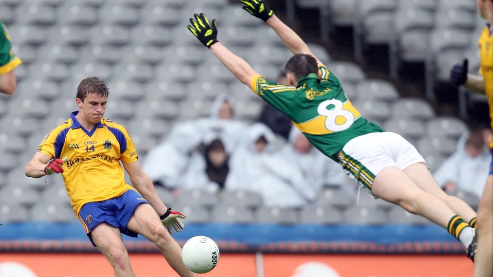 Roscommon's Kevin Finn kicks for goal as Kieran Murphy of Kerry tries to block