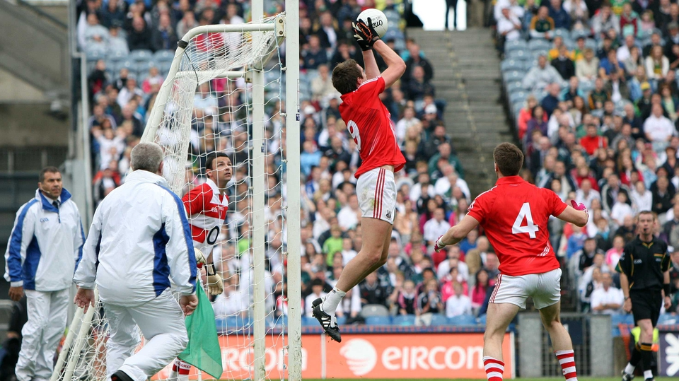 Cork's Aidan Walsh gathers a free that drops short of the crossbar