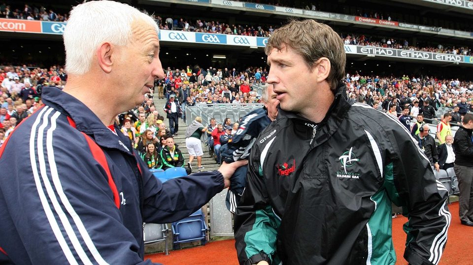 Cork manager Conor Counihan (l) commiserates with Kildare counterpart Kieran McGeeney