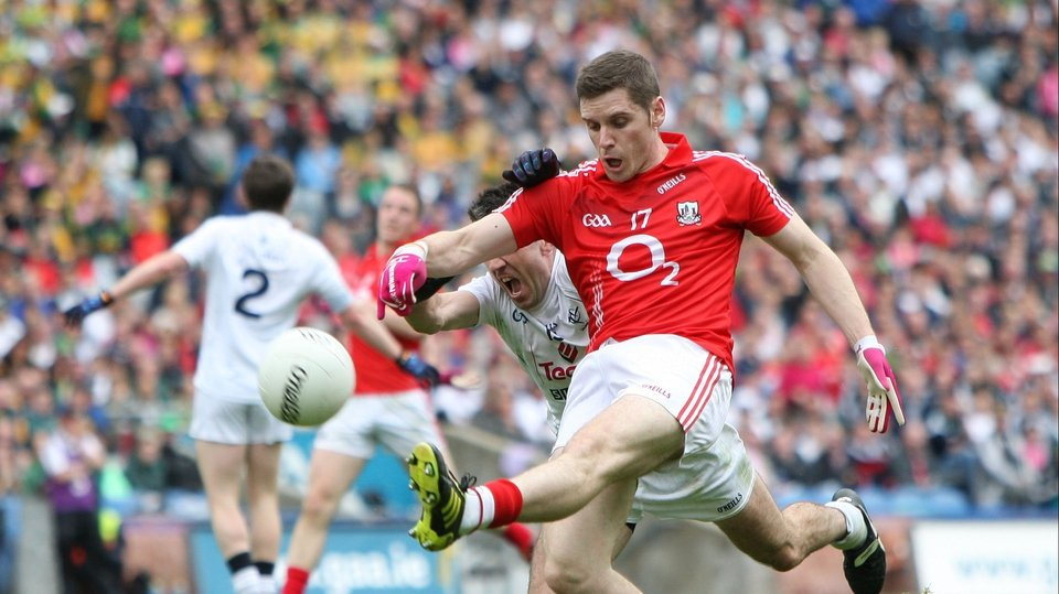 Cork's Daniel Goulding shoots for goal as he is challenged by John Doyle of Kildare