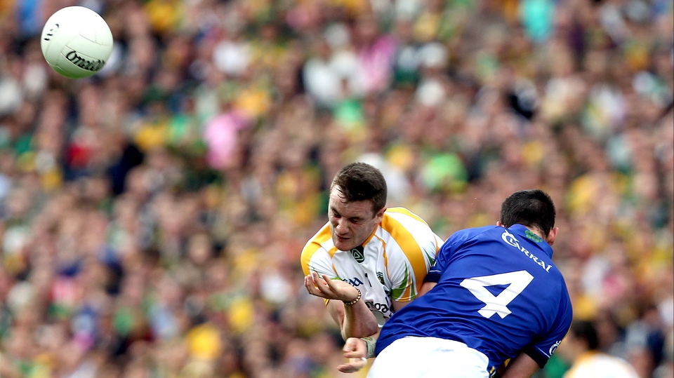Donegal's Leo McLoone collides with Shane Enright of Kerry