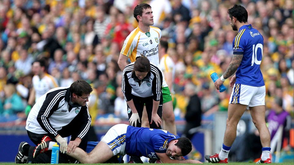 Kerry midfielder Bryan Sheehan is treated for an injury