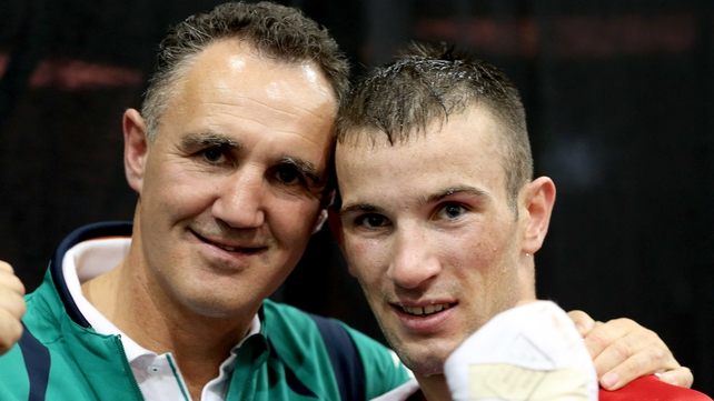 Nevin celebrates afterwards with his coach Billy Walsh