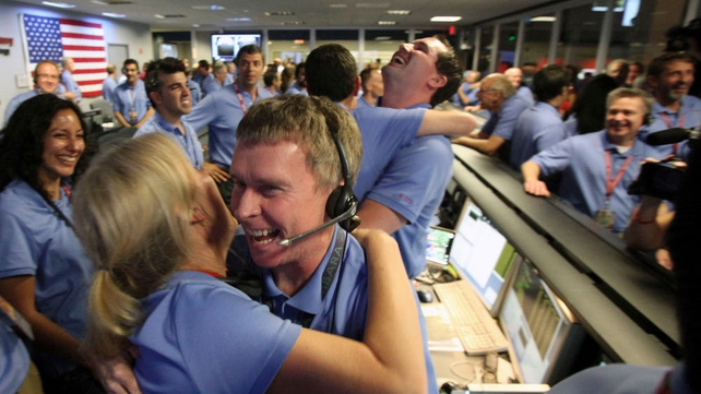 NASA ground control staff in Pasadena celebrate the successful landing