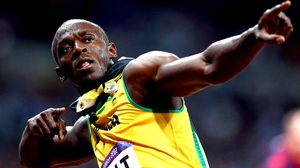 Usain Bolt cruised into the 200m final