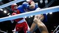 Boxing: Taylor guaranteed medal after stunning win