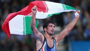 Omid Noroozi celebrates after winning wrestling gold