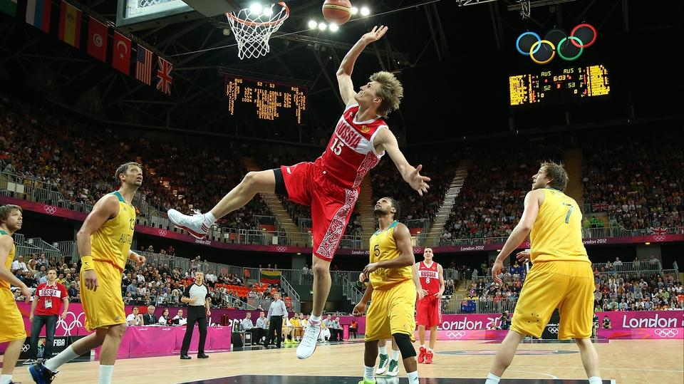 Andrey Kirilenko of Russia gets a shot away against Australia