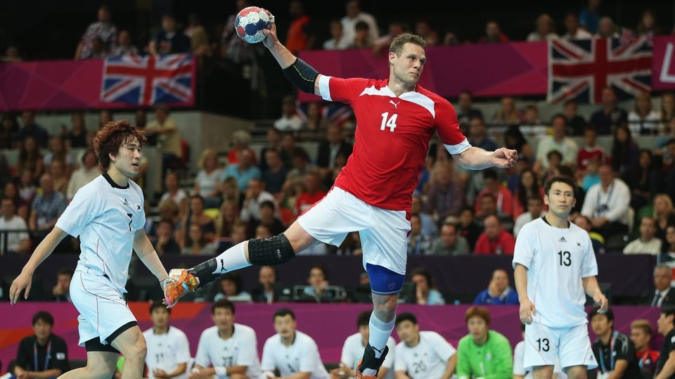 Michael Knudsen of Denmark takes a shot in the handball clash with South Korea
