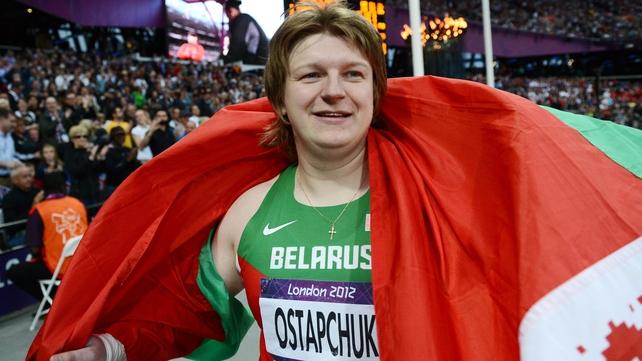 Belarusian Nadzeya Ostapchuk celebrates her shot put gold medal