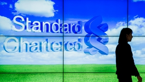 Standard Chartered says markets remain challenging as it takes big hit on Korean business